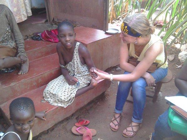 Volunteer visits famy of Children with disabilities in Ugandan village